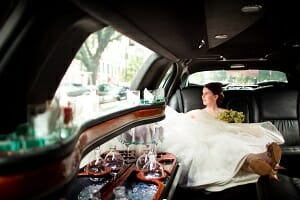 Girl in wedding dress in limo